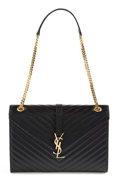 Free shipping and returns on Saint Laurent 'Cassandre' Leather Shoulder Bag at Nordstrom.com. A gilt logo insignia proclaims label loyalty on a pristine leather shoulder bag elegantly crafted with a structured envelope silhouette and meticulous matelassé stitching.