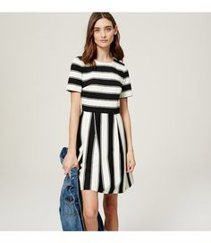 """As bold as it is femme, this smooth ponte flare lines things up in sharp stripes. Round neck. Short sleeves. Pleated skirt. Hidden back zip. 20 1/2"""" from natural waist."""