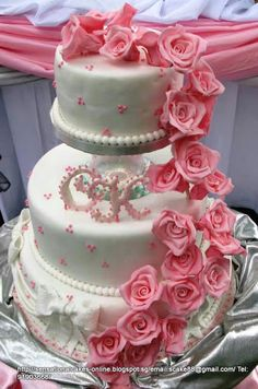 Beautifully crafted pink roses 3 tier Wedding Cake.