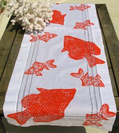 Bright Tangerine Orange Fish Table Runner. ( Maybe with a bluish table?)
