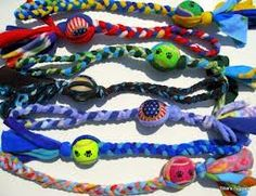 DIY Dog Toy: T-shirt twist with ball…..try using a racket ball instead of tennis…...