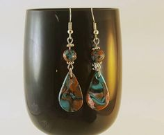 Check out this item in my Etsy shop https://www.etsy.com/listing/537350126/orange-turquoise-silver-and-black-dangle