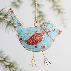 Handcrafted by artisans in India, our lovely metal bird ornaments will nest cozily in your tree. This set of three features unique patterns on each beautiful bird.