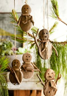 Driftwood snowman ornament. Thin slabs and slender twigs of natural driftwood form our scarved snowman ornaments.