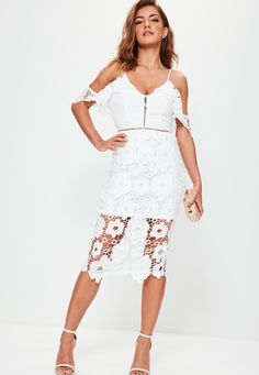 Ultimate femme vibes in this white lace midi dress! With a lace overlay, spaghetti straps and crochet details, you are sure to pack a punch!
