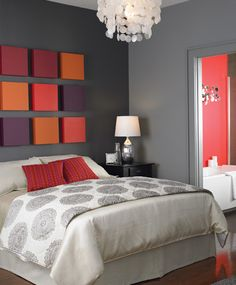 I like the vivid colors in the otherwise colorless room! It's sort of like a headboard and art work at the same time . love the grey and polka dots too.  Rent-Direct.com - Apts for Rent in NYC with No Broker Fee.