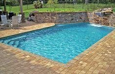 Geometric swimming pool with cascade waterfall