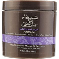 Naturally Silk Elements Whipped Curl Cream locks in moisture and defines curls, providing a soft, manageable finish.