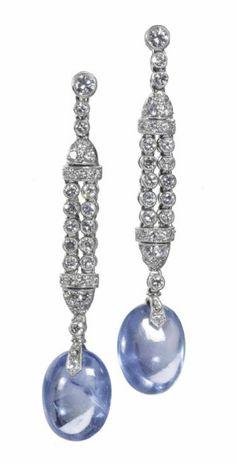 A PAIR OF ART DECO SAPPHIRE AND DIAMOND EAR PENDANTS, BY J. STELTMAN. Each designed as a double line of flexible millegrain-set circular-cut diamonds suspending sapphire bead drop, with screw back fittings. #ArtDeco #Stelman