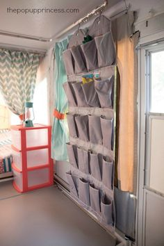 Use small pocket organizers, hung from the curtain tracks of your camper, to store camping essentials like sunscreen, bugspray, and flashlights.