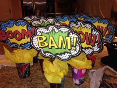 I made these for Tre's Birthday using the superhero plastic cups found in the party section of Wal-mart, wrapped floral foam with tissue paper, used bamboo skewers to attach comic word printout with a black card stock backing. Book Birthday Parties, Wild One Birthday Party, Superhero Birthday Party, Diy Birthday, Breakfast Table Decor, Superhero Centerpiece, Justice League Party, Candy Topiary, Superhero Baby Shower