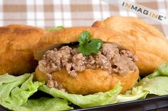 Vetkoek (pronounced FET-cook) is a traditional Afrikaner pastry. It is dough deep-fried in cooking oil and either filled with cooked mince (ground beef) or spread with syrup honey or jam Cooking Oil, Ground Beef, South Africa, Hamburger, Fries, Syrup, Meat, Honey, Traditional