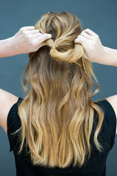 """Pull hair into a half-up half-down style, leaving a few face-framing pieces out, and secure with a clear or hair-colored elastic. Next, take hold of the bottom part of the pony. """"This style is perfect for when you have some wave and movement to the hair,"""" says Peña, who suggests applying TRESemmé Perfectly (un)Done Wave Creating Sea Foam then twisting hair into a loose braid before bed.   - MarieClaire.com"""