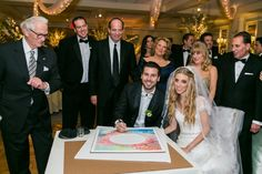 """Couple signing """"Four Seasons"""" from Ketubah.com!"""