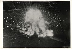 1944- Outlined against the explosion of its own bombs, U.S. Army 9th Air Force P-47 Thunderbolt fighter plane has just destroyed a Nazi ammunition truck.