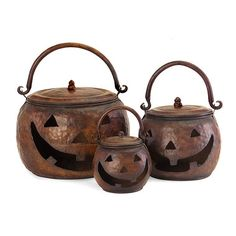 Honoring a metalsmith's craft, these metal Jack-o'-lanterns pots have a rustic, handcrafted look that adds warmth and style to any setting. Made of hammered iron with a copper patina finish, this set of three pumpkins feature a cutout face, a carrying handle and a lid. Perfect for hold small pillar or tea candles.