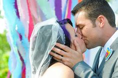 Angela & Rob's sprinkles and glitter rainbow wedding... like their ribbon backdrop idea.