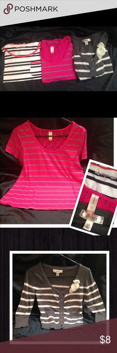 3 Striped Tops! These are so cute! The first is white with black stripes & a pink trimmed neckline (scoop neck) & decorative chest pocket. The brand is FRESH & it's size PL. The second is a stunning hot pink with gray stripes and a lace back! It's No Boundaries XL. Both of these are a short style but flow more than a crop top. The third top is a sweater like material & is dark gray with white stripes, functional buttons, 2 decorative pockets & flowers. Decree L. All in good condition and fit…
