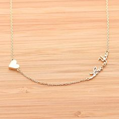 tiny HEART & LOVE YOU necklace, (2 colors) | girlsluv.it from bythecoco.com. Saved to gifts from brett :). #loveit #gold #want #loveyounecklace #heartnecklace.