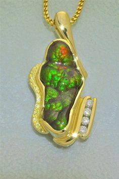 Glenn Dizon Designs.  One of a kind fire agate and diamond pendant in 18K