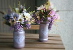 recycled jars with artificial flowers