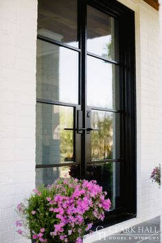 Custom iron front doors transform the design of any entrance. With large glass panels to let in all the natural light, these modern, contemporary double doors take your exterior french door ideas to the next level. Modern Entry Door, Double Front Entry Doors, Double Doors Exterior, Iron Front Door, Exterior Doors With Glass, Contemporary Front Doors, Front Door Entrance, Glass Front Door, Modern Contemporary
