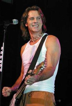 Rick Springfield :) I won his Working Dog album from a radio contest.  Dr. Drake!!