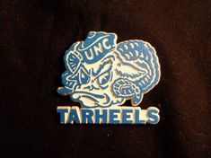 New in my #etsy shop: Vintage University of North Carolina Tarheels Refrigerator Magnet, UNC College Memorabilia, Collectible Refrigerator Magnet, UNC Tarheels http://etsy.me/2nbrR1G  #vintage #refrigeratormagnet #UNC #Tarheels #UniversityofNorthCarolina #gift