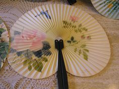 Vintage Paper Fan With Blue Butterfly and Pink Rose Flowers and Green Foliage, Accordian Fan, Collectors Item, Metal Handle.  No rips or tears in fan. Excellent used condition.  5 1/2 x 10 fan extended  Costume accessory, Compact fan that is small enough to fit anywhere.  Beautiful on wall as home decor.  Must - have accessory when attending outdoor events such as weddings.  Beautiful addition to any fan collection.  This is for one fan.