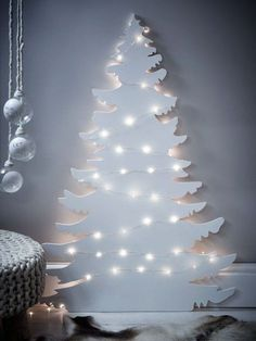 a Christmas tree silhouette wall art with lights