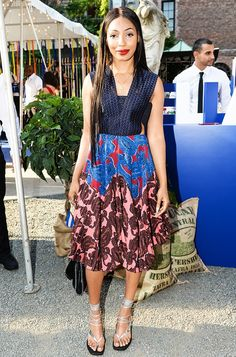 Wynter Gordon wears a printed midi dress and silver lace-up sandals