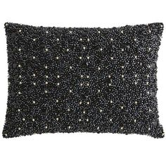 Forgoing modern industry tools, Indian artisans have meticulously crafted this lumbar pillow by hand. It features thousands of multisized beads in cool shades of black and gold for a celestial effect. It's destined to be the star of your living room.
