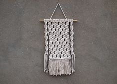 Macrame wall hanging Color: off-white. Material: unbleached cotton rope, wood. Length of the wood is approx 38 cm (15 inches); macrame canvas is approx max 29 x 57 cm (11.5 x 22.5 inches) More macrame wall hangings https://www.etsy.com/shop/PapuShoi?section_id=19482238 If you have any