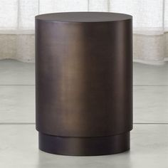 Shop Patina Bronze Drum Table.   A smart recessed plinth base makes it easy to position.  When used in multiples sides may bow slightly, making them not perfectly flush.  The Patina Brass Cube Table is a Crate and Barrel exclusive.