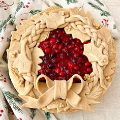 Pie crust Christmas wreath honey and cranberry apple pie with heavy applied crust of braid, leaves and festive bow Holiday Pies, Holiday Baking, Christmas Baking, Christmas Pies, Christmas Holidays, Merry Christmas, Vodka Pie Crust, Apple Pie Crust, Pie Crust Recipes