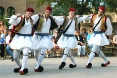 Our men wear skirts and do flips, without shame! Opa!