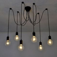 Add a unique, art deco flavor to your space with this funky cluster pendant lamp. Pin up the cords to your liking, leave them hanging straight, or wrap around d