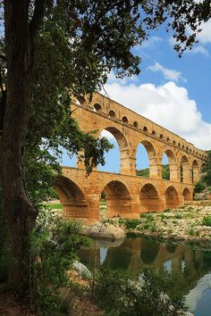 The Pont du Gard is an ancient Roman aqueduct bridge that crosses the Gardon River in south of France