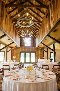 Chandeliers and elegant table clothes make for a fancy barn wedding.