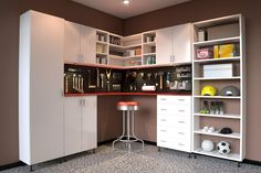 Basic white melamine work bench allows you to stand and work. Open shelves for affordable storage.