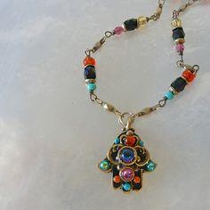 The Magical Animal - MICHAL GOLAN Kaleidoscope Hamsa Necklace, $95.00 (http://www.themagicalanimal.net/products/michal-golan-kaleidoscope-hamsa-necklace.html/)