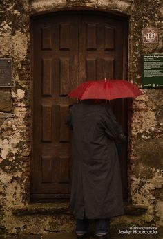 "500px / Photo ""Red umbrella"" by Javier Hourcade"