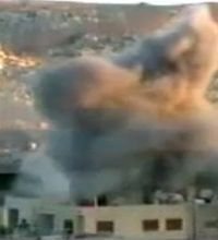 This image taken from video obtained from Ugarit, which has been authenticated based on its contents and other AP reporting, shows an explosion during heavy fighting between rebels and Syrian government forces in the Barzeh district of Damascus, Syria, Friday, April 26, 2013.