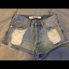 Brandy Melville High Waisted Destroyed Denim Jean shorts from Brandy Melville! super distressed. High waisted, size 26. Only worn a handful of times, condition is great. Perfect for the upcoming Spring/summer season! Brandy Melville Shorts Jean Shorts