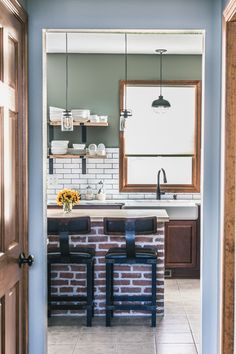 Welcome to my Black Stainless Kitchen Renovation! White subway tile, quartzite countertops, wood island, exposed brick, and black stainless appliances Rustic Kitchen Cabinets, Farmhouse Style Kitchen, Modern Farmhouse Kitchens, Black Kitchens, Kitchen Black, Kitchen On A Budget, Home Decor Kitchen, Kitchen Bar Design, Stainless Kitchen
