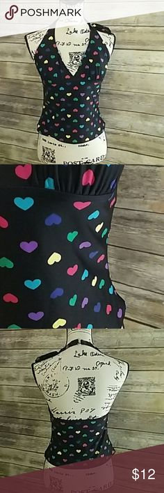 "Delia's Multicolored Heart Tankini Top Size Large Super cute black tankini top with different colored hearts all over, lightly padded!! Delia's brand size large. Measures approximately 13.5"" underarm to underarm unstretched and 9"" long at back unstretched. Delias Swim"
