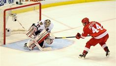 Detroit Red Wings right winger Todd Bertuzzi, right, is stymied by Chicago Blackhawks goalie Corey Crawford in an overtime shootout of an NHL hockey game at Joe Louis Arena in Detroit, Saturday afternoon, April 7, 2012. The Blackhawls won 3-2 in a shootout. (AP Photo/Lon Horwedel)