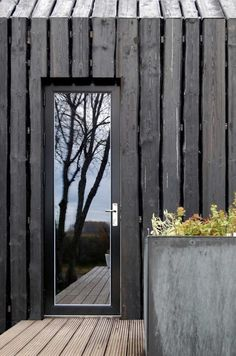 Mirrored front door, and wooden paneled walls