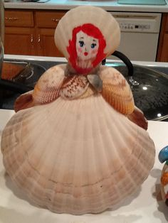 My red headed daughter painted the red headed shell doll...beautiful!