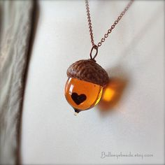 This hand-made glass acorn in Topaz has an encased hand-cut copper heart and is topped with an actual acorn cap sealed in museum quality wax.
